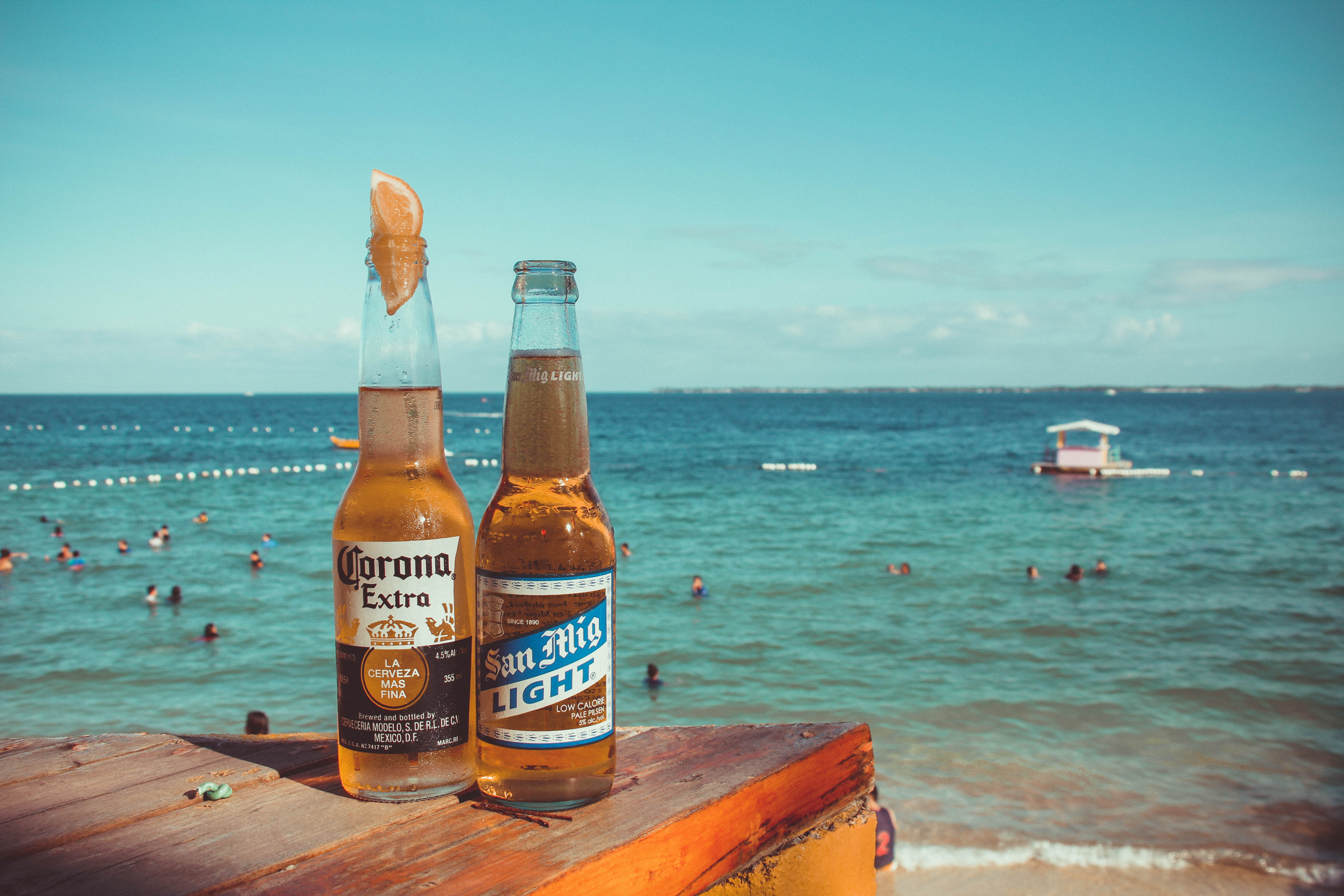 two-corona-extra-and-san-mig-light-beers-on-top-of-brown-767239.jpg