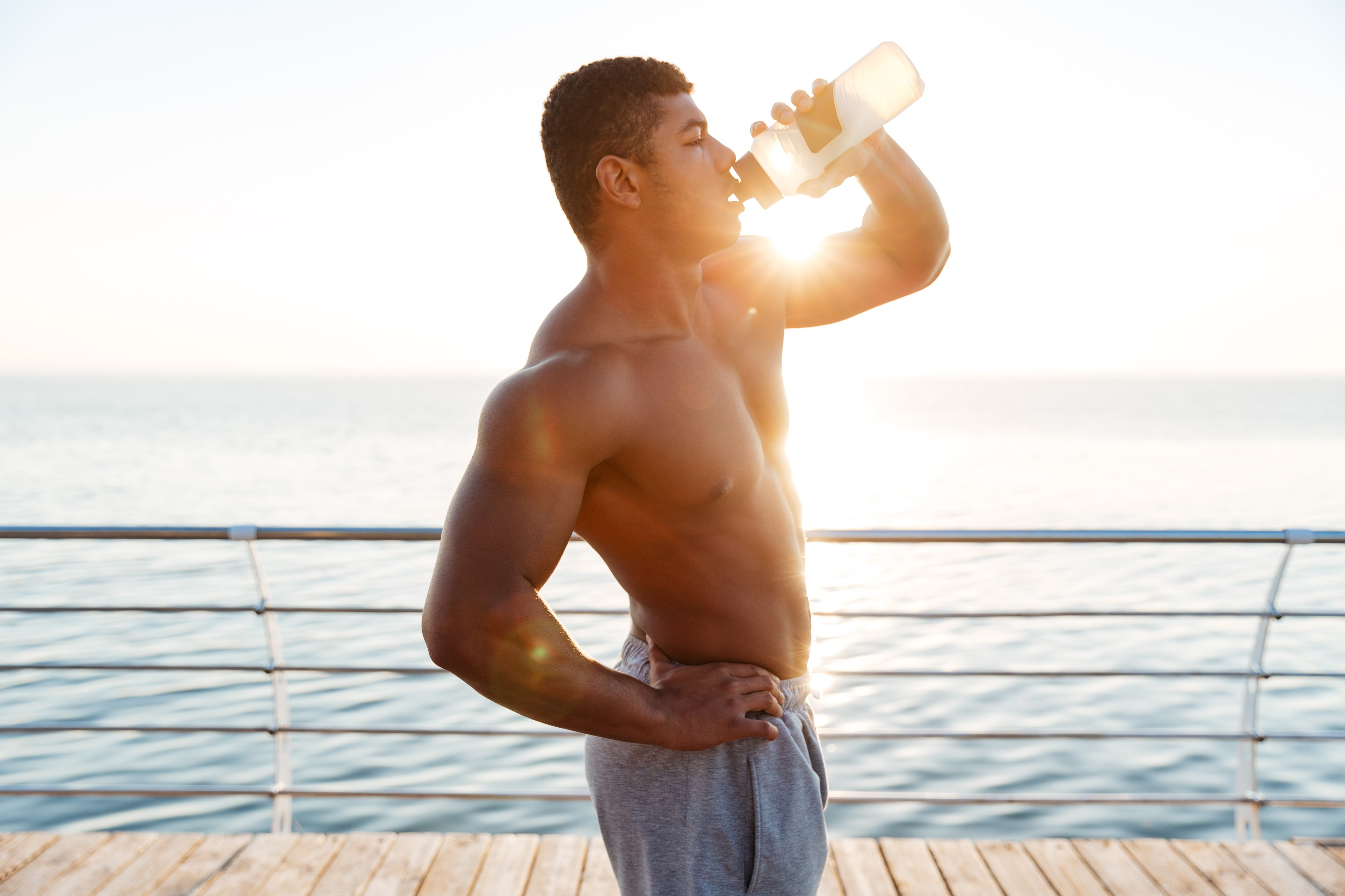 graphicstock-attractive-shirtless-muscular-african-american-young-man-drinking-water-on-pier_ruXwzOdB2l (1).jpg